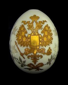 EXCEEDINGLY RARE AND IMPORTANT Imperial Presentation porcelain Easter egg with two-tone gilded double-headed eagle, made at the Imperial Porcelain Factory in St. Petersburg around 1890. Height 3 3/4 in. (9,5 cm) A similar egg but with cobalt blue ground and gilded branches from the Goop collection is illustrated in 'Kostbare Ostereier aus dem Zarenreich', Vaduz-Munich, 1998. $ 25,000.00