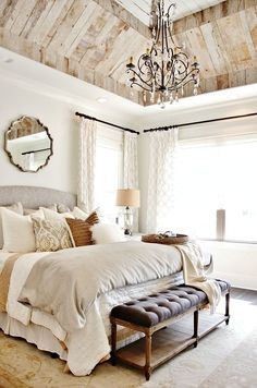 With a few affordable pieces from Target, World Market and Bed Bath & Beyond, you can recreate the luxe chalet feel of this look. A mixture of whites, taupes and grays allows you to mix patterns with gusto while maintaining an understated elegance in your bedroom.