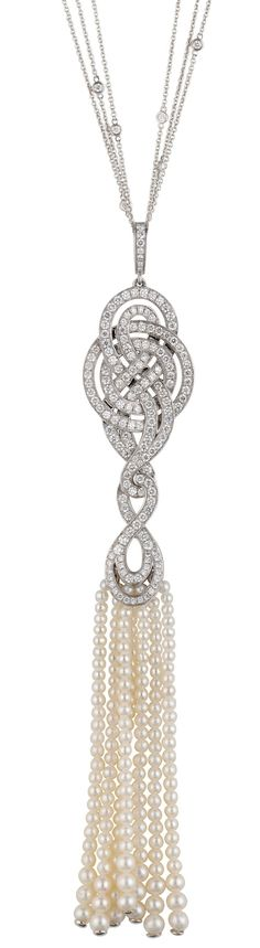 A pendant from Garrards Entanglement collection with a delicate bead tassel of pearls below a gold and diamond knot.