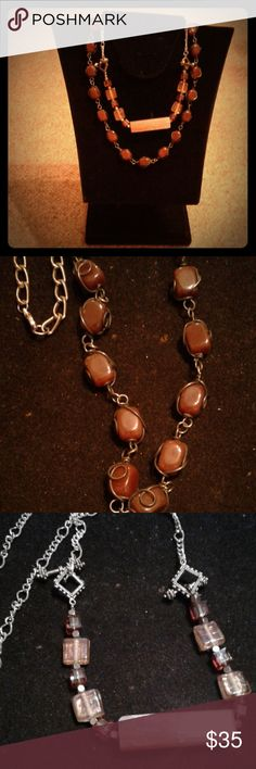 "Bundle of 2 stone necklaces unique handmade NWOT First necklace is carnelian stones caged in gunmetal color wire wrap connected together. Silver tone chain on top 22"" length. Second necklace is toggle to toggle strung glass amber beads, pewter beads with large rectangle quartz focal bead. Strung section connected to silver tone chain. 24"" long. Southwestern Creations Jewelry Necklaces"