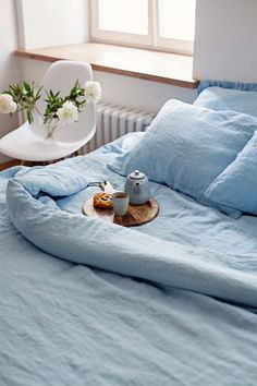 A simple yet stunning light blue linen bedding set is perfect for a bedroom refresh. Crafted from stone washed linen, it's very soft against the skin and easy to care for. Light Blue Bedding, Blue Duvet, Blue Pillows, Linen Pillows, Linen Bedding, Bed Linens, Light Blue Bedrooms, Sheets Bedding, Rustic Bedding