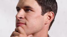 """""""Sidney Crosby of Cole Harbour, Nova Scotia speaks to reporters at the Canadian national men's team orientation camp in Calgary, on Sunday, Aug. 25, 2013."""" (AP Photo/The Canadian Press, Jeff McIntosh)"""