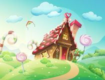 Sweet house of cookies and candy on a background of meadows and growing caramels. Royalty Free Stock Images
