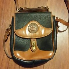 Vintage dooney and bourke black leather crossbody Vintage dooney and bourke black leather crossbody purse. Measures 9x8 inches. Clasp closure. Some wear and fading along trim. Also has a couple spots. Metal has some scratches. Dooney & Bourke Bags Crossbody Bags