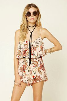 A woven romper featuring a flounce layer, abstract floral print, V-neckline, spaghetti straps, back cutout, and an elasticized waist.