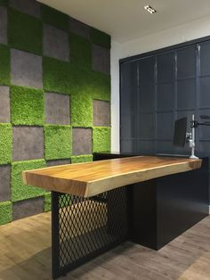 the new OfficeWorks @ Johor Jaya feature wall made up of wood vinyl, hexagon shaped tiles, and grass carpet natural solid plywood meeting table/workspace natural rain tree wood slab finished off with custom carpentry and wrought iron wire mesh: