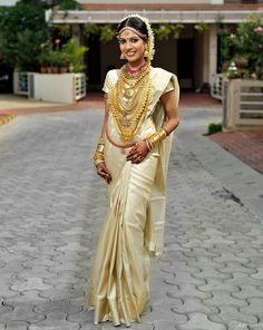 Elegant in cream and gold saree, south indian bride