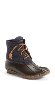 Staying stylish, warm and comfy rain or shine with these adorable Sperry waterproof rain boots.