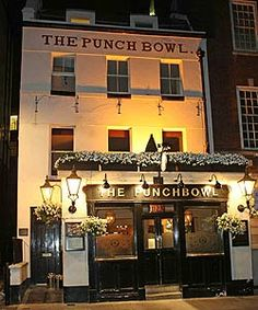 The Punchbowl , London.  Lovely little tucked away bar.  Very traditional, old English with an unassuming air about it (even though it is owned by Guy Ritchie).  Always busy with the locals after work.  Food great too!  Reminiscent of a country tavern where you can relax and chill with friends.