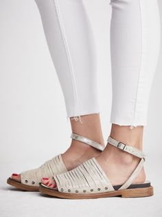 Lone Star Sandal | Made from a super soft leather sandals featuring tribal-inspired accents.    * Crisscross straps   * Toe loop   * Adjustable buckle ankle strap   * Sizing Tip: This style runs true to size.  If between sizes, size up.