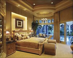 """Sater Design's """"Alamosa"""" home plan from our luxury home plan portfolio. Master Suite and sitting area."""