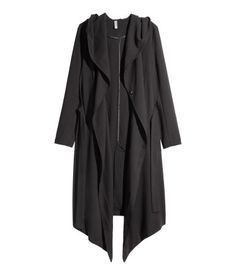 Double-breasted coat in lightly woven crêpe fabric. Hood, side pockets, concealed snap fasteners at front, asymmetrical hem with slit at back, and a tie belt. Unlined.