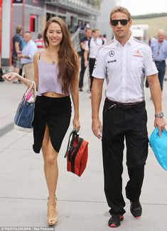 Flashing some flesh: Jessica Michibata wore a cropped top and a skirt with a revealing split as she and Jenson Button took a stroll in Hungary