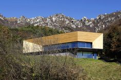 """Located in a clearing close to the """"Passo del Cavallo"""" in Italy, this single family house by Camillo Botticini Architetti relates to the Alpine landscape and fits in the ground. Wood Facade, Wood Siding, Contemporary Architecture, Architecture Design, Italy House, Exterior Cladding, Italian Villa, Wood Detail, Commercial Architecture"""