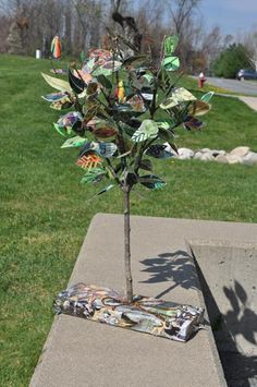 "Class Project??? Tree with leaves from magazine and old book pages.  Use laminator or contact paper to cover leaves after students finishing drawing on them.  Here bright colored papers and drawing tools make a ""loud"" tree.  Just pencil drawings on neutral papers make a ""quiet"" tree."