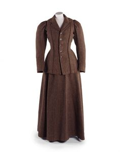 Woman's brown and green tweed suit, by J.R. Dale & Co., British, 1896-1905. Tailor made suits were smart, practical and versatile outfits. The warm, durable tweed from which this suit is made suggests that it was worn for country walks and travelling.