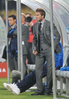 Manly? Check. Suit? Check. Sporting event? Check. Soccer player? Check, check, check!!!