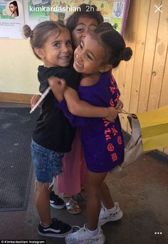 'BFF's': On Wednesday, Kim Kardashian, 36, shared an adorable photo to Instagram Stories of North West, four, and Penelope Disick, five, hugging their pal, Ryan