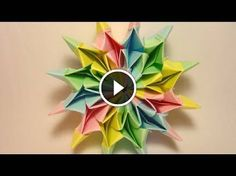 If you won't be near any real fireworks for the of July holiday, do the next best thing and origami yourself some! For this origami fireworks project, you'll need square sheets of paper of different colors. Origami And Quilling, Origami And Kirigami, Paper Crafts Origami, Origami Stars, Origami Flowers, Flor Magnolia, Fireworks Design, Origami Tutorial, Paper Folding