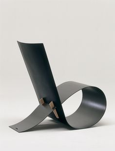 The sleek lines of the 1997 Loop chair by Niels Hvass