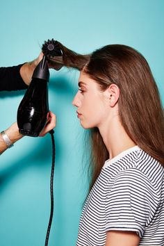 Prep hair with oil prior to blowdrying or air-drying. No need to be precious with how you dry the hair, just get it semi-straight, with one exception: The front section should be pulled forward and blowdried back, like you see here. This will create a smooth bend in the hair, which you'll see ahead. #refinery29 http://www.refinery29.com/2016/12/132182/la-hairstyles-sal-salcedo-styling-tips#slide-23