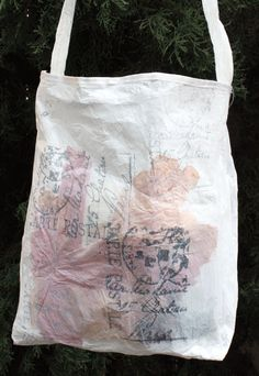fused plastic grocery bags with ink stamped designs resewn into tote bag!  Who thinks of doing this??