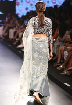 Sita powder blue saree with navy blue blouse
