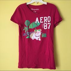 "Pink Bulldog Summer Beach Graphic Tee Shirt Top !! ❌SOLD❌ // 🐶☀️ This is so cute! ⛱ 🎉 // Aeropostale ""Aero '87"" Beach Sun Bulldog Pup Puppy Dog Doggy Kawaii Adorable Glitter Shimmer Tropical Summer Graphic Design Print Short Sleeve Bright Hot Pink Tee Shirt Top //🌴 It was a LIMITED EDITION summer release in 2010. //📻 🏖 No longer in production. SOLD OUT in stores & online! //💕 Brand new // NO flaws // Women's Large. Looks cute oversized too! 💚 // Lightweight 🍒🍓🍉 SOFT knit & comfy…"