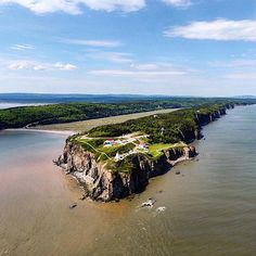 One of my favourite photos that we captured during our Canadian Road Trip was this drone shot over Cape Enrage, New Brunswick. This an awesome place to visit around the Bay of Fundy, complete with history and fun activities such as zip-lining! New Brunswick, Newfoundland, Fun Activities, Road Trip, Places To Visit, Zip Lining, Canada, My Favorite Things, Day