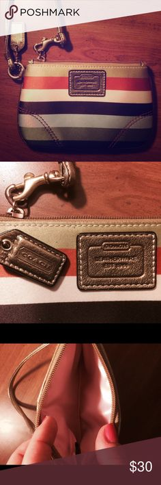 Coach wristlet Coach wristlet with horizontal stripes. In good condition, measures 4 x 6 inches. Coach Bags Clutches & Wristlets