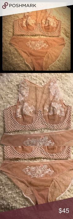 High neck bra and matching panty Lace appliqué detail on bra and panty. Sheer mesh fabric with eyelet mesh details. High neck style bra and cheekini style panty. Never worn. Bra never worn or washed, no tag attached. Panty bought online so it does not come with a tag. Victoria's Secret Intimates & Sleepwear