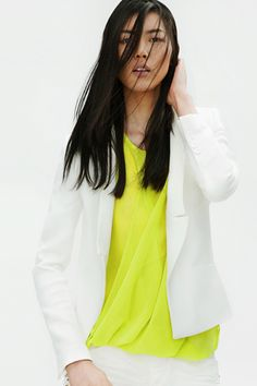 LOVE the look of this bright neon flowing spring blouse with the white blazer