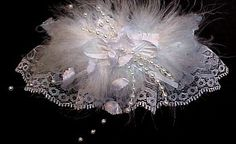 It's your shining moment. Deluxe May bells Bridal KEEPSAKE Garter with feathers and strands of pearls. Ready for your wedding. Style #W2-MB / Visit: www.garters.com/page11h.htm