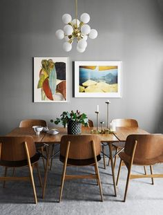 Stylish lighting for homes. Dining room idea with colorful framed pictures, large wood table and grey walls. Dining room idea with colorful framed pictures, large wood table and grey walls. Decoration Inspiration, Dining Room Inspiration, Decor Ideas, Decorating Ideas, Design Inspiration, Dinning Room Ideas, Neutral Decorating, Decorating Websites, Wall Ideas
