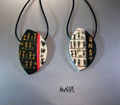 Lovely pendants by Ingrid Ulrich using the ancient people stamp.