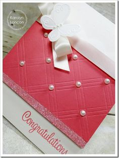 Berry Sorbet is the color of this paper, and it sure is a sweet card!  Diamond-shaped embossing and white pearls make up the front of the card, along with smooth white ribbon and an embossed butterfly.