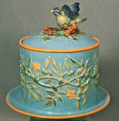Jones Majolica Biscuit Jar, Bird & Trumpet Vine Bird. Wings replaced. Original not flared.| Majolica International Society image from the Karmason Library.