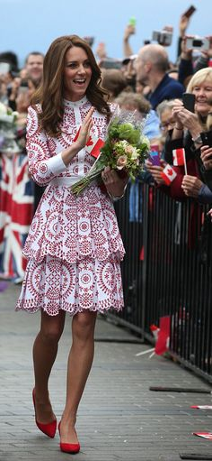 In a nod to the nation's flag, Catherine, Duchess of Cambridge chose a £4,000 red and white Alexander McQueen frock and she paired with red pumps and a clutch bag for her first full day of public engagements.