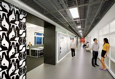 With Flying Colors: Gensler Designs NYSID's New Headquarters | George Nelson benches line the 140-foot-long main corridor's rubber floor. #design #interiordesign #interiordesignmagazine #architecture #university #hallway #school #wallpaper @gHospitality