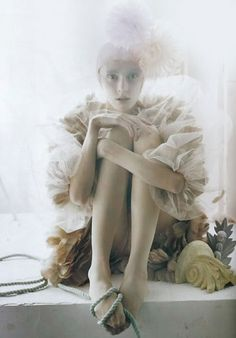Tim Walker  http://designtraveller.blogspot.ca/2010/12/imaginary-kingdom-of-tim-walker.html