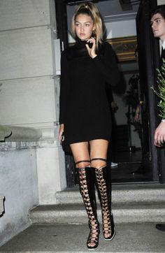 Sweater Weather: GiGi Hadid in black turtleneck #sweater dress + knee-high #boots + top ponytail #hair. #stylish