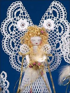 Majesta - crochet angel figure worked with size 10 crochet cotton using size 5 steel crochet hook - Inexpensive e-pattern available via PatternsCentral