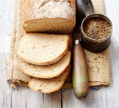 This rye bread recipe is lower in gluten than your average white loaf - this recipe uses white or wholemeal flour to give a light texture but you can experiment with ratios, from BBC Good Food.
