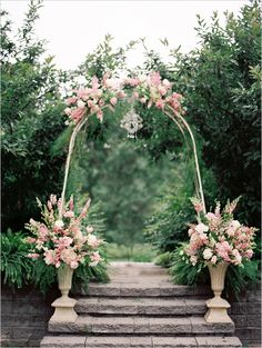 beautiful arch with pink florals http://www.weddingchicks.com/2013/09/04/gold-and-mint-wedding-ideas/