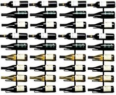 Set of 4 Wall Mounted 9 Bottle Black Wrought Iron Wine Racks - 36 Total Bottles by True. $139.95. Includes screws. Black wrought iron. Holds 9 Bottles each - 36 total. Holds nine bottles each. Saves space. Set of 4 Wall Mounted 9 Bottle Wine Racks        This wine rack can be mounted vertically to a wall, allowing you to save space.   It can securely hold up to nine bottles of wine.   Its black wrought iron construction means it is durable and easy on the eyes.   Screws are inclu...