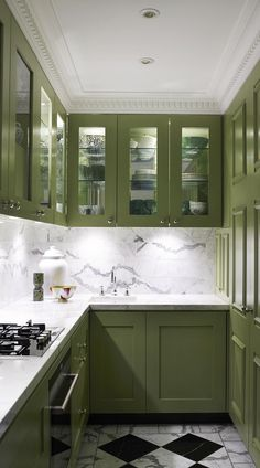 The Best in Dark Green Kitchen Trends - Town & Country Living Olive Green Kitchen Cabinets with Checkerboard Floor Green Kitchen Cabinets, Kitchen Cabinet Colors, Painting Kitchen Cabinets, Kitchen Paint, New Kitchen, Kitchen Ideas, White Cabinets, Colored Cabinets, Kitchen Walls