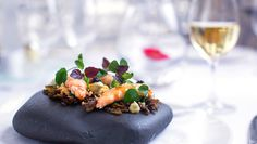 Langoustine tails on a rock with Ebène caviar by Mark Jordan