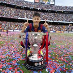 NEYMAR Jr. with the La Liga trophy, the first.