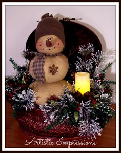Large palm woven basket with locking lid ~ Roly poly vintage snowman, frosted ming pine, rusty jingle bells, lacquered berries & wax coated flicker candle.  $50
