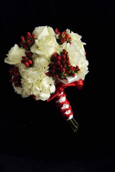 "Candy Cane Bridesmaid Bouquet.... Perfect winter bouquet! With ""Proud"" white roses, white hydrangeas and red hypericum berries as accents."